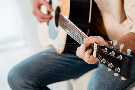Photo for Cropped view of man playing acoustic guitar - Royalty Free Image