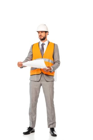 Photo for Handsome engineer in suit and hardhat holding blueprint on white background - Royalty Free Image