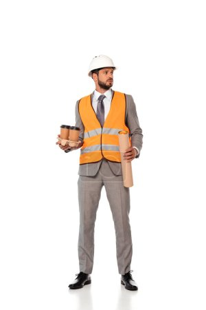 Engineer in suit and hardhat holding paper cups and blueprint tube on white background