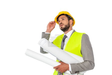 Engineer in suit holding hardhat and blueprints isolated on white