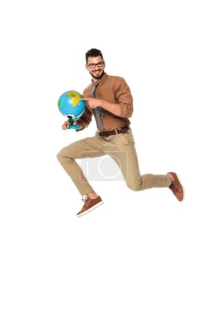 Positive teacher pointing with finger at globe while jumping isolated on white