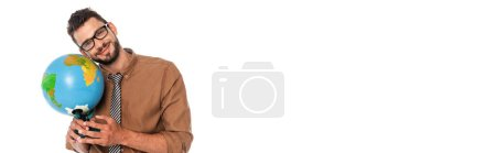 Panoramic shot of positive teacher looking at camera while holding globe isolated on white