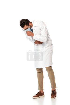 Photo for Diseased doctor in medical mask coughing on white background - Royalty Free Image