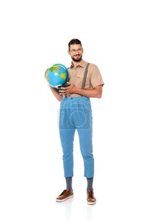 Photo for Smiling bearded nerd in eyeglasses holding globe on white background - Royalty Free Image