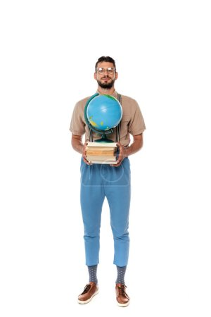 Handsome nerd holding books and globe and looking at camera on white background
