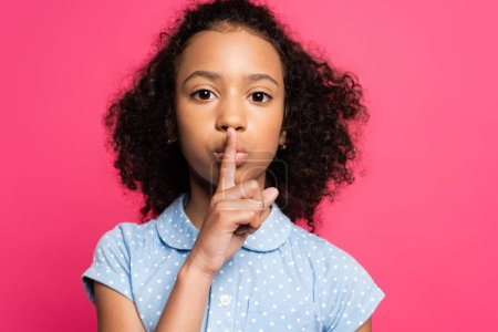 cute curly african american kid showing shh sign isolated on pink