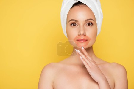 Photo for Naked beautiful woman with towel on head, lip patch isolated on yellow - Royalty Free Image