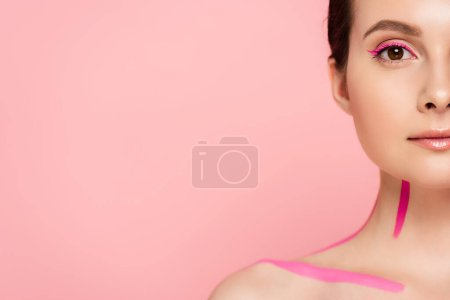 Photo for Cropped view of naked beautiful woman with pink lines on body isolated on pink - Royalty Free Image