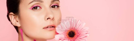 beautiful woman with pink lines on body and chrysanthemum isolated on pink, panoramic shot