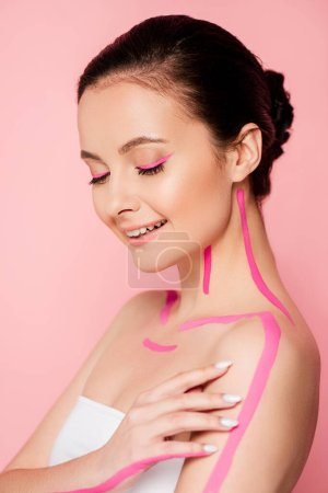 Photo for Smiling beautiful woman with pink lines on body isolated on pink - Royalty Free Image