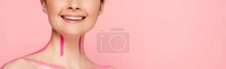 Photo for Cropped view of smiling naked beautiful woman with pink lines on body isolated on pink, panoramic shot - Royalty Free Image