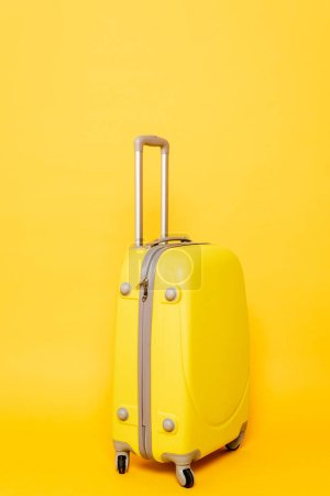Photo for Colorful travel bag on yellow background - Royalty Free Image
