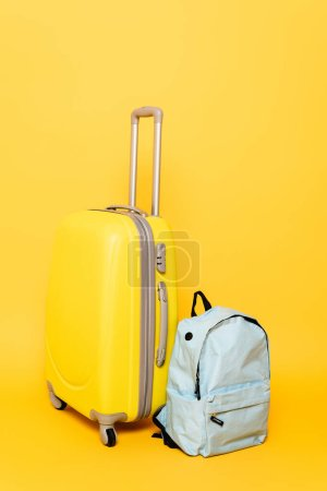 Photo for Travel bag with backpack on yellow background - Royalty Free Image