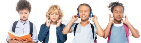 Photo pour Panoramic shot of multicultural schoolkids listening music in wireless headphones near curly boy reading book isolated on white - image libre de droit
