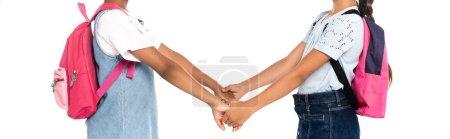Photo pour Culture panoramique d'écoliers multiculturels tenant les mains isolées sur blanc - image libre de droit