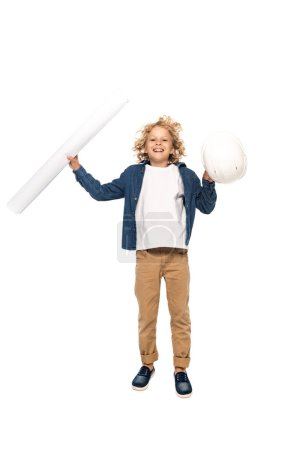 curly boy in costume of architect holding safety helmet and blueprint while jumping isolated on white