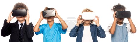 Photo for Panoramic shot of multicultural kids dressed in costumes of different professions touching virtual reality headsets isolated on white - Royalty Free Image