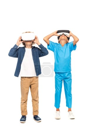 Photo for Kids touching virtual reality headsets isolated on white - Royalty Free Image