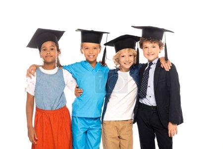 Photo pour Enfants multiculturels en casquettes de fin d'études vêtus de costumes de différentes professions isolés sur blanc - image libre de droit
