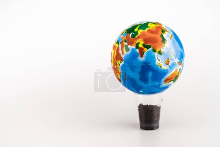 Photo pour Globe on plastic cup with ground on white background - image libre de droit