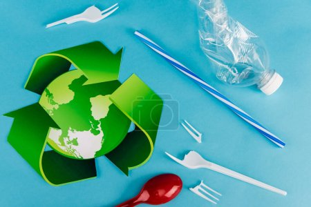 Photo for Top view of recycling symbol near plastic rubbish on blue background - Royalty Free Image