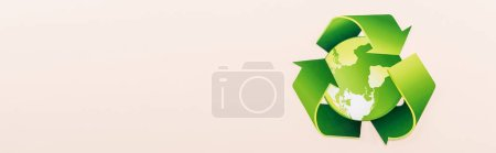Photo for Top view of green recycling symbol with planet isolated on beige, panoramic shot - Royalty Free Image