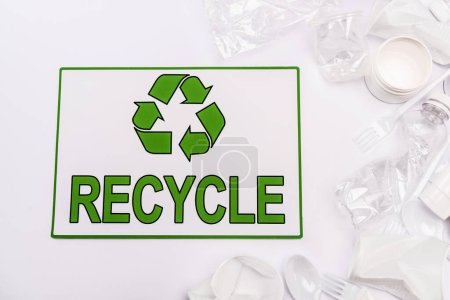 Photo pour Top view of recycle card and plastic rubbish scattered on white background - image libre de droit