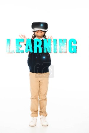 Photo for Full length view of african american schoolgirl in virtual reality headset on white background, learning illustration - Royalty Free Image