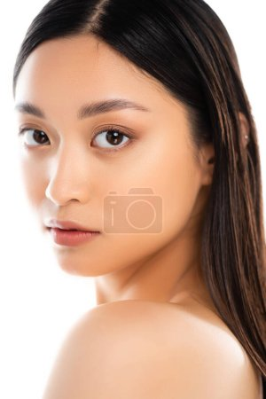 Portrait of young asian woman looking at camera isolated on white