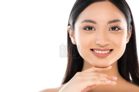Photo pour Portrait of excited young asian woman looking at camera and touching face isolated on white - image libre de droit