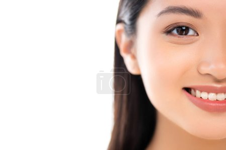 Partial view of excited young asian woman looking at camera isolated on white