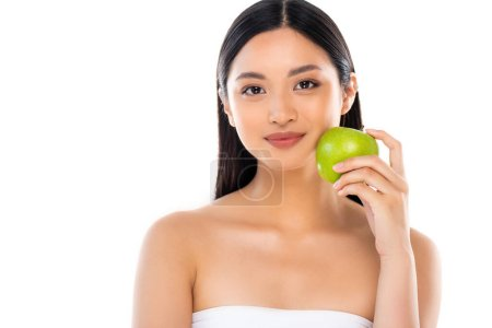 Photo for Young asian woman looking at camera and holding apple isolated on white - Royalty Free Image