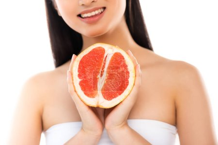 Photo pour Cropped view of woman holding half of juicy grapefruit isolated on white - image libre de droit