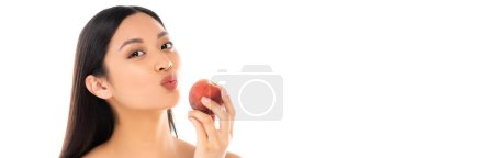 Photo for Panoramic concept of asian woman making duck face while holding juicy peach isolated on white - Royalty Free Image