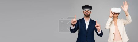 Photo pour Website header of businesspeople in vr headsets gesturing like touching something isolated on grey - image libre de droit