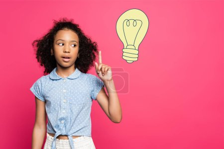 Photo for Curly african american kid showing idea gesture near light bulb illustration on pink - Royalty Free Image