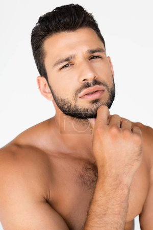 Photo for Shirtless and bearded man touching face isolated on white - Royalty Free Image