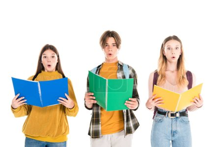 Photo for Excited teenagers looking at camera while holding notebooks isolated on white - Royalty Free Image