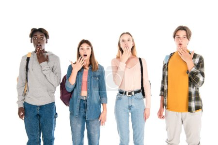 Photo for Surprised multiethnic teenagers looking at camera isolated on white - Royalty Free Image
