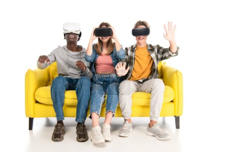 Multiethnic teenagers smiling while using vr headsets on white background