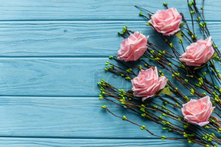 Photo for Wooden blue background with blossoming branches and roses - Royalty Free Image