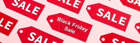 website header of labels with sale and black friday lettering on pink