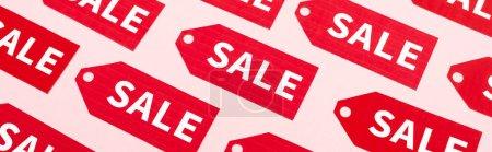 website header of labels with sale lettering on pink, black friday concept