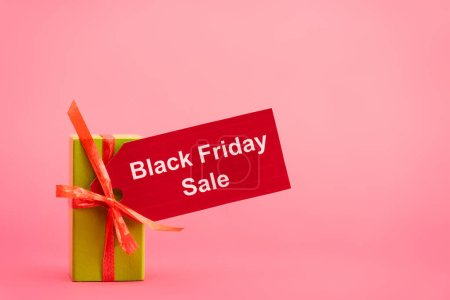 Photo for Gift box with black friday sale tag on pink - Royalty Free Image