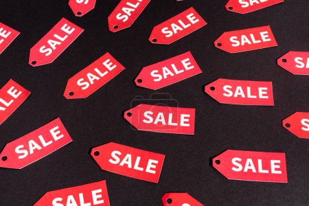 red labels with sale lettering on black background
