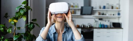 Photo for Blonde woman wearing vr headset, horizontal banner - Royalty Free Image