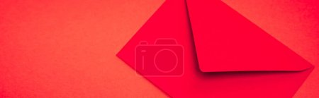 Photo for Top view of envelope on red background, banner - Royalty Free Image