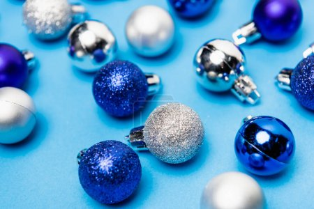 Photo for Shiny Christmas baubles on blue background - Royalty Free Image