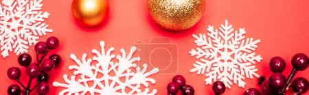 Photo for Top view of baubles, snowflakes and berries on red background, banner - Royalty Free Image