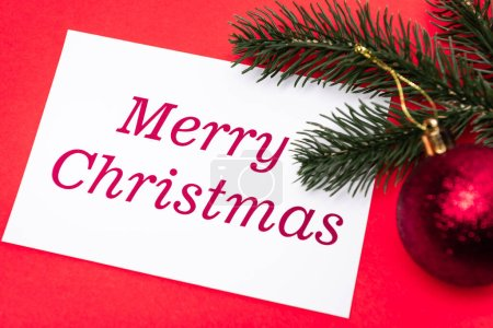 merry Christmas card and decoration on red background